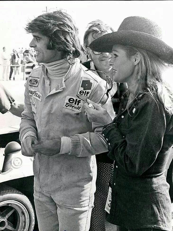Francois Cevert & Ursula Andress  @ The Glen Can Am 1972  Chris Economaki between them !