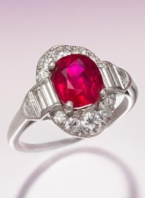 An Art Deco Platinum, Burmese Ruby and Diamond Ring. Containing one oval mixed cut ruby weighing approximately 2.17 carats, four baguette, two trapezoid, six round transitional brilliant and four old European cut diamonds weighing approximately 1.50 carats total. #ArtDeco #ring