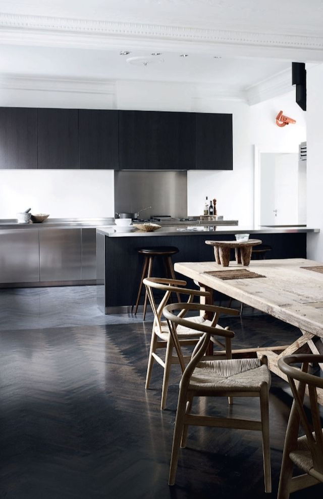 dark modern kitchen with a rustic dining table