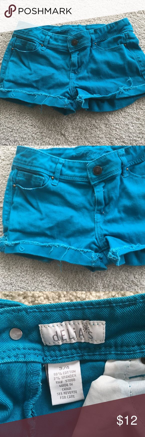 Women's jean shorts by Delia's size 3/4 These are a gently used pair of Women's blue shorts by Delia's. The blue is a gorgeous turquoise color. Size 3/4, 98% cotton, 2% spandex.                                                                   Features a ripped denim look at the bottom of the shorts. Taylor Shorts Jean Shorts