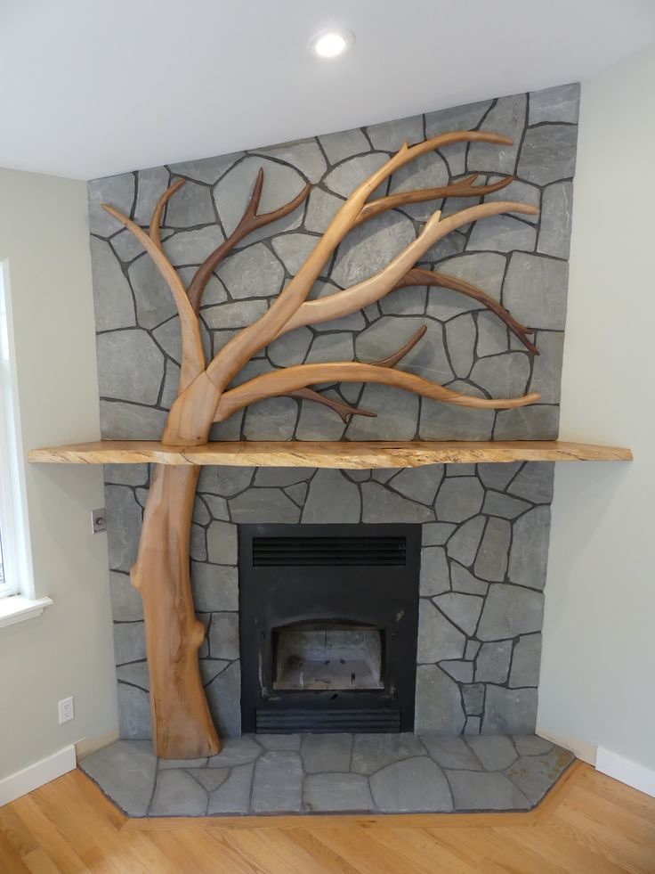 Live edge mantle and tree installation by Live Edge Design