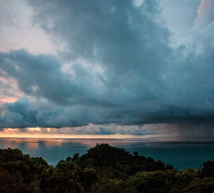 Rainy season in Costa Rica comes with violent bursts of percipitation.  Last night I was lucky enough to see one such storm approaching as the sun set in the background.  #costarica #quepos #manuelantonio #storm #sunset #nature #cloud #costaricagram #travel #rainy #tico