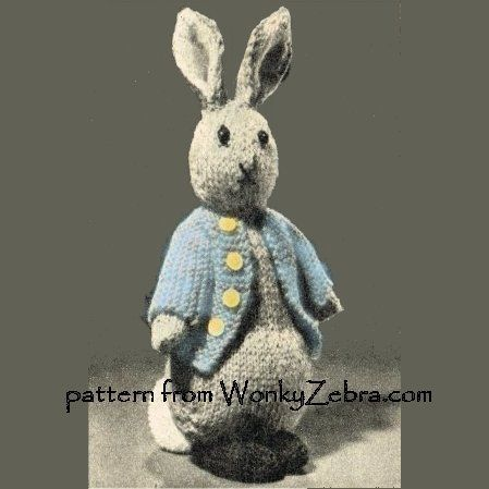 "WZ735. A knitted bunny rabbit, wearing a cute little jacket.He sits up with a tubby tummy on two padded feet.the image is black and white but who can resist a blue Peter rabbit style""version."