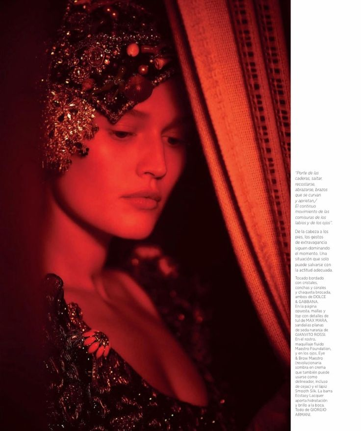 Toni Garrn poses in embroidered headdress and brocade jacket from Dolce & Gabbana
