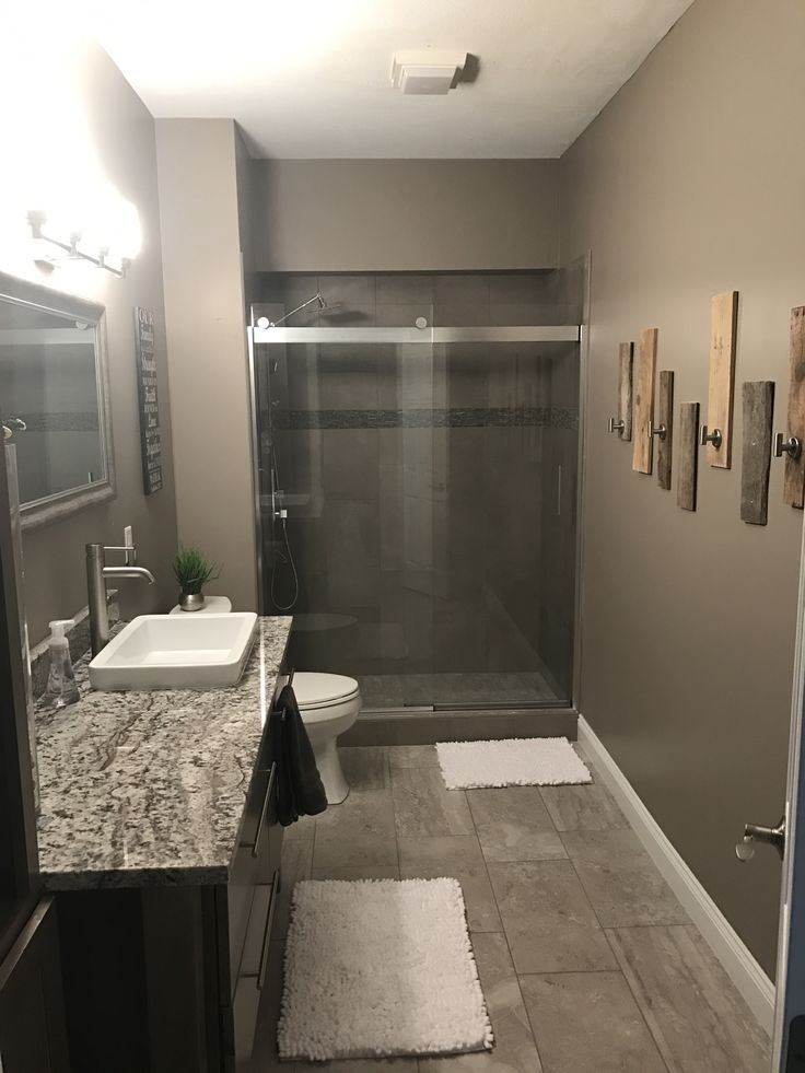 Our newly remodeled basement bathroom: platinum maple cabinetry, granite countertop in Azul Aran, pallet wood towel hooks, glass sliding door from lowes!
