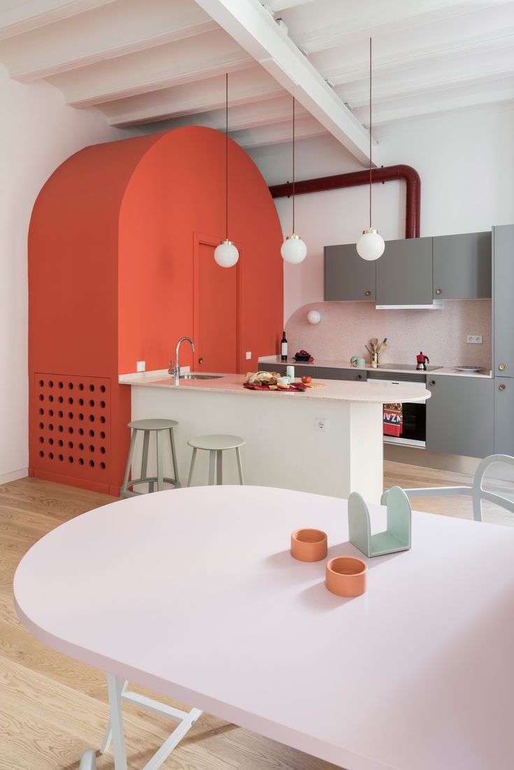 Colombo and Serboli Architecture has made room for colourful storage units and a pink bathroom by opening up the plan of this apartment in Barcelona's historic El Born neighbourhood.