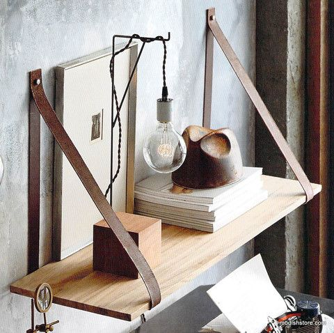 Our cool, clean-lined leather shelves are a Danish design inspired by 1930's campaign furniture. Acacia wood shelves are wrapped with rawhide leather hanging straps and held fast by nickel-plated meta