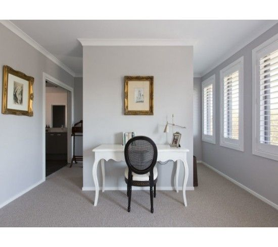 Marie Doyle - Basswood Plantation Shutters in 'Bright White'