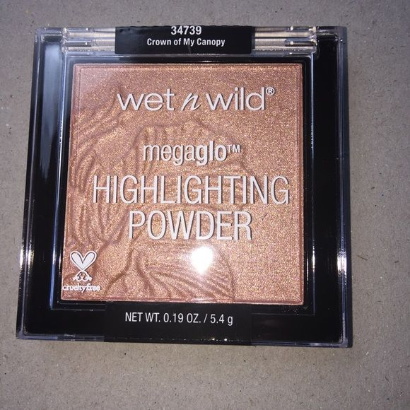 Wet n Wild Megaglo Highlighting Powder *New* Wet n Wild Megaglo Highlighting Powder *New* Crown of my Canopy Never used Brand New gorgeous color so pigmented and creamy  best drip store highlight limited edition don't miss out  Wet n wild Makeup Luminizer