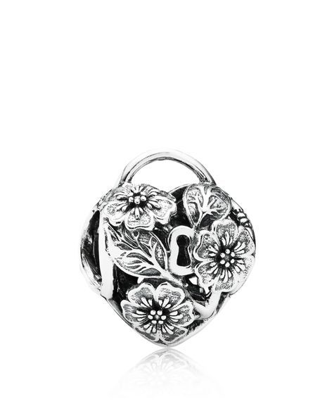 Inspired by a secret garden, Pandora's sterling silver heart padlock charm is covered with beautiful blooms. | Sterling silver | Imported | Style #791397 | This item is only compatible with products f