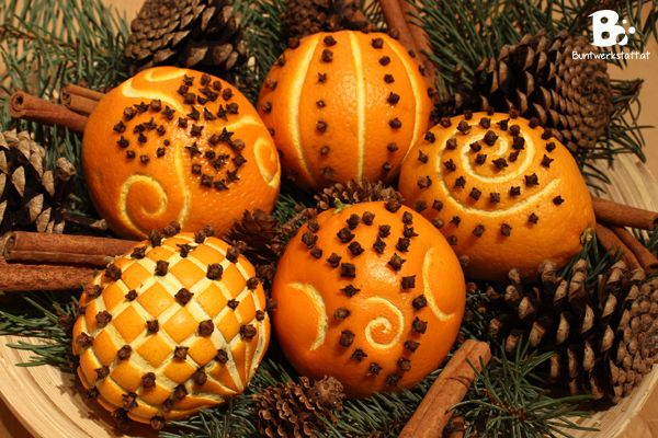 oranges and cloves pomanders for christmas or yule with pagan symbols: