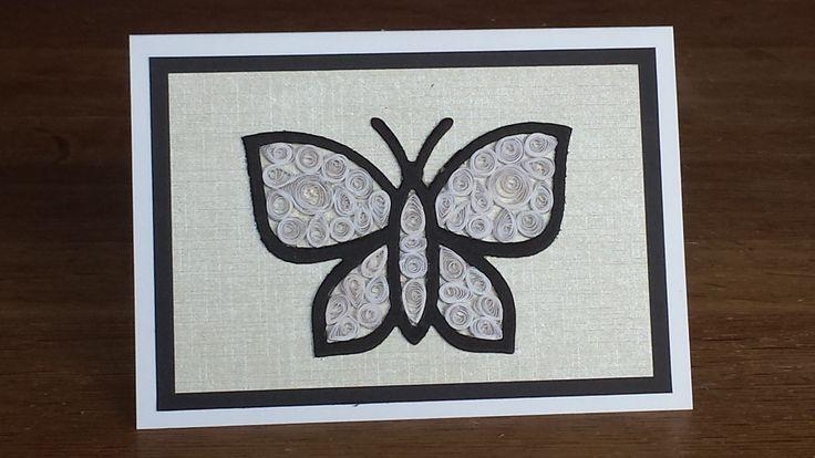 Vlinder van foam met filling die papierrolletjes gevuld