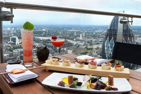 BANK- Sushi Samba- situated in the Heron Tower....hence the stunning views. Serving a mix of Japanese, Peruvian and Brazilian food. This is a special kind of occasion place. http://sushisamba.com/