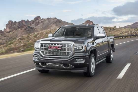 2016 GMC Sierra 1500 Denali 4x4 front three quarter in motion 06 - Provided by MotorTrend