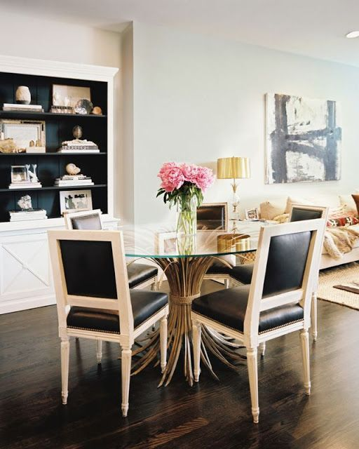 Dining room: great table and chairs, with white painted wood built-in shelving. Via @Habitually Chic.