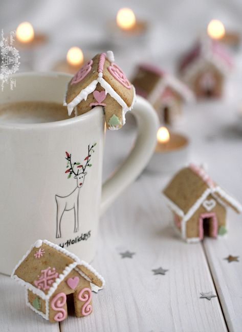 """This great tutorial for making tiny gingerbread houses designed to sit comfortably on the brim of a mug comes from a competition on Polish blog Cake Time."" This is too cute"