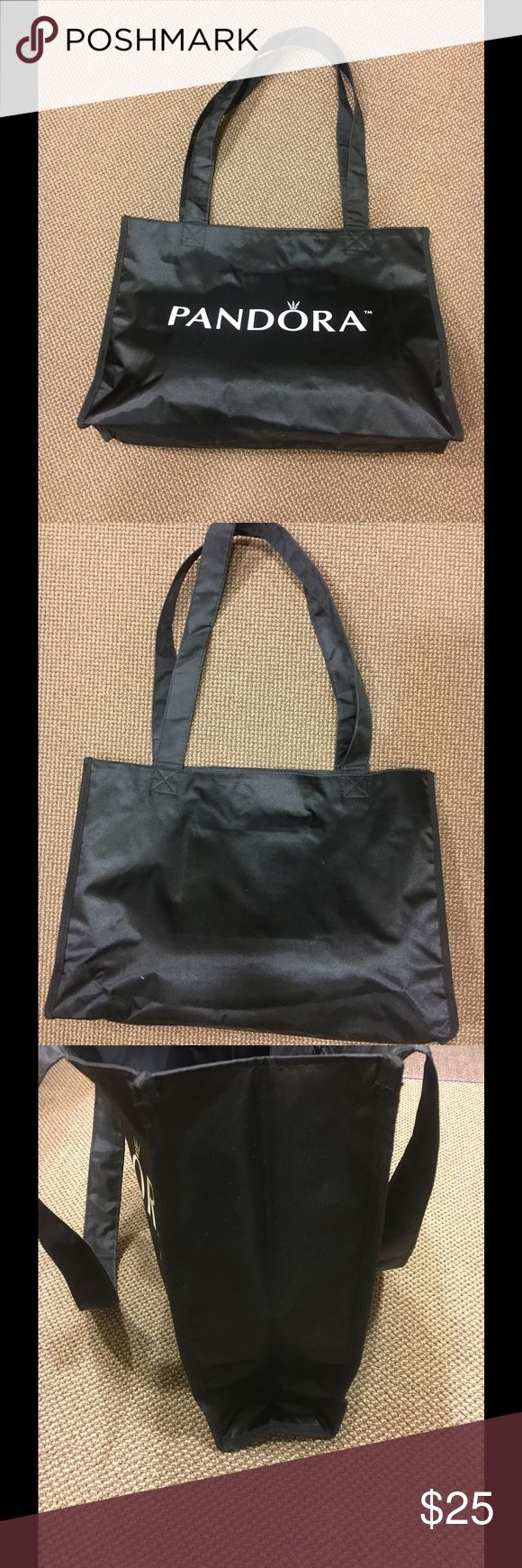 New!!! Large black tote bag w/Pandora TM Large black tote bag w/ Pandora TM . Inside zipper pocket . Folds easily so you can pack in a suitcase for those vacations. Great for shopping sprees, beach trips, pool. Lots of room and will wipe of easily Bags