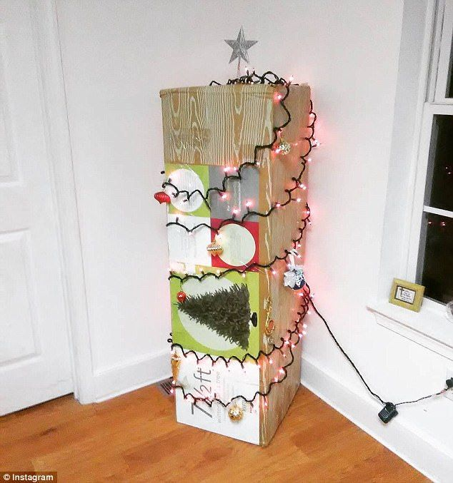 Many attempted to create their own Christmas trees, with one family using cardboard boxes wrapped in festive lights