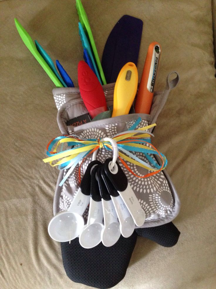 Utensils and kitchen gadgets in a potholder and oven mitt for a bridal shower gift
