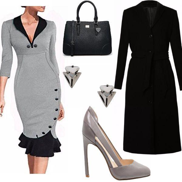Stufa di andare a lavoro vestita sempre nello stesso modo? Hai una riunione e non sai cosa mettere? Prova con un vestito iper-femminile come questo abbinato ad una maxi-cappotto, che va tantissimo di moda quest'inverno.