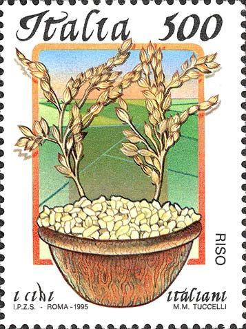 """1995 - """"Cibi italiani"""": Il Riso -  ciotola colma di riso con due piante del cereale e, nello sfondo, alcune risaie"""