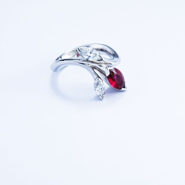 Floral platinum ring with marquise cut ruby and diamonds. #JonDibben #marquise #diamond #ruby