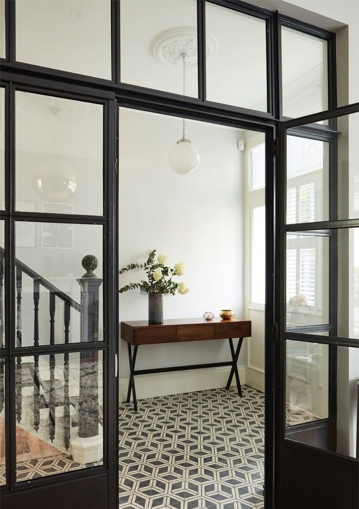 Hallway with tiled floor black and glass doors