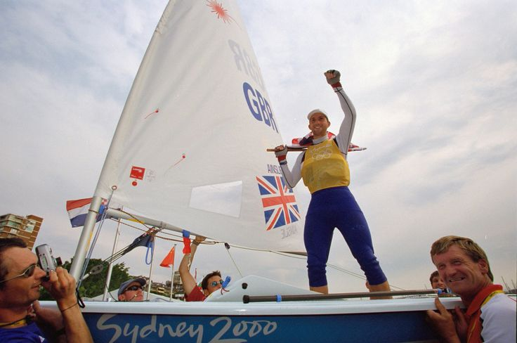 Ben Ainslie of Great Britain celebrates a provisional gold after the Final Open Laser Sailing at the 2000 Olympic Games in Sydney.