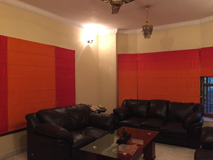 Gradient effect from red to burnt orange. Indian dupion silk Roman blinds