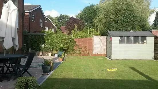 Back garden- new block paved patio and new turf. August 2014