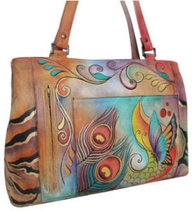 These Anuschka bags are really works of art. Each is hand-painted on beautiful, soft leather, and no two are exactly alike. Even better, the bags are designed so well that they are magically spacious inside without seeming too big.