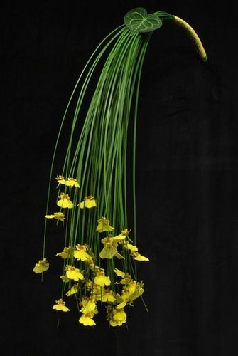 Modern arm sheaf bouquet of Oncidium orchids + steel grass