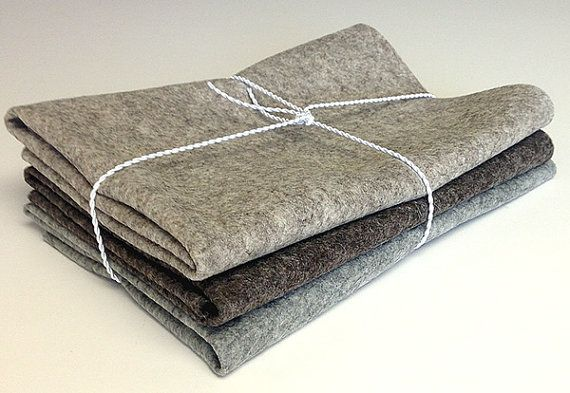 """Heather Gray, Heather Light Brown & Heather Dark Brown 100% Merino Wool Felt 3-Piece Bundle 18"""" x 18""""    This 100% Merino wool felt 3-piece bundle is 1.1mm (3/69"""") in thickness and weighs 15 ounces per linear yard. Each piece measures 18"""" by 18"""". The colors are perfect for use in a Primitive style wool felt applique project.    The Merino wool felt is manufactured in Europe and is certified safe for babies, adults and children.    The Merino wool felt is non-raveling and easy to cut in any…"""