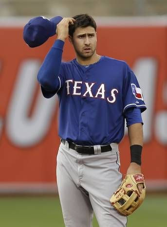 Texas Rangers' Joey Gallo removes his cap during a baseball game against the Oakland Athletics Wednesday, June 10, 2015, in Oakland, Calif. (AP Photo/Ben Margot)