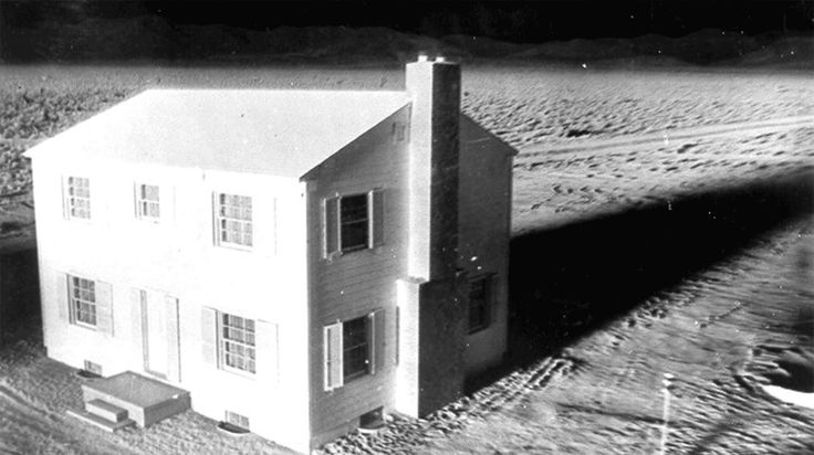 Complete destruction of House No. 1, located 3,500 feet from ground zero, by an atomic blast on March 17, 1953, at Yucca Flat at the Nevada Proving Ground. The time from the first to last picture was 2.3 seconds. The camera was completely enclosed in a 2-inch lead sheath as a protection against radiation. The only source of light was that from the bomb. In frame 1, the house is lit by the blast. By frame 2 the radiating energy has set it on fire, and the remaining frames show the rapid…