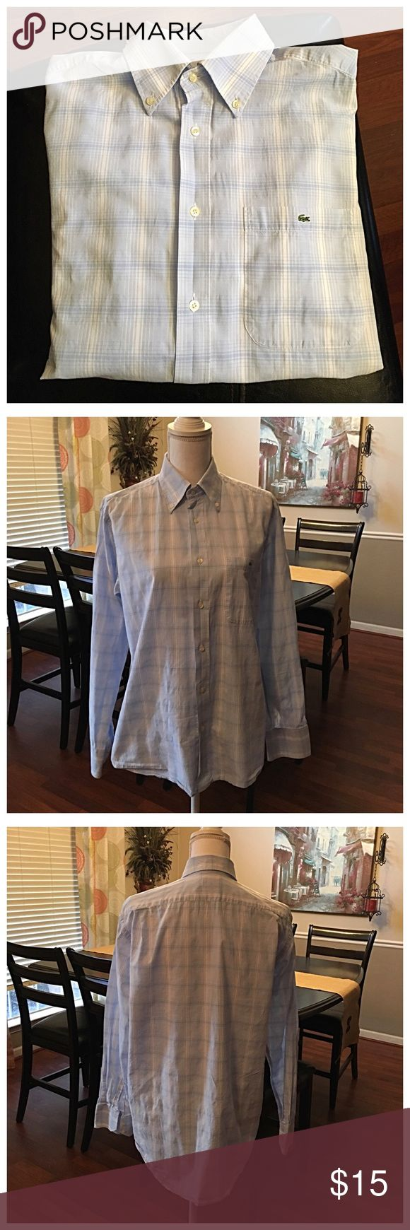 Lacoste Men's dress shirt! Lacoste Men's dress shirt!!  Very nice shirt. No holes stains or tears. Shirt has never been dried. Size medium. Thanks for shopping my closet💋 Lacoste Shirts Dress Shirts