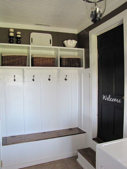 adding a mudroom to our garage, garages, home improvement, laundry rooms, We stored hats and gloves in the baskets above the coat rack