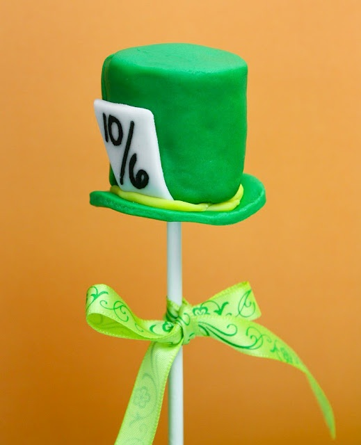 "I spent a lot of time thinking up ways to reference as many things from the movie as I could.  Since it was a ""Mad Hatter's Birthday Tea Party"" I just had to include the iconic Mad Hatter's big green hat!  This is a large marshmallow covered in green fondant.  The brim of the hat is a disc of fondant cut-out slig"