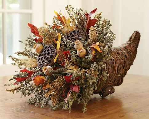 cornucopia brims with sweet annie, lotus and poppy pods, broom corn, wheat, marjoram, savory and preserved autumn leaves