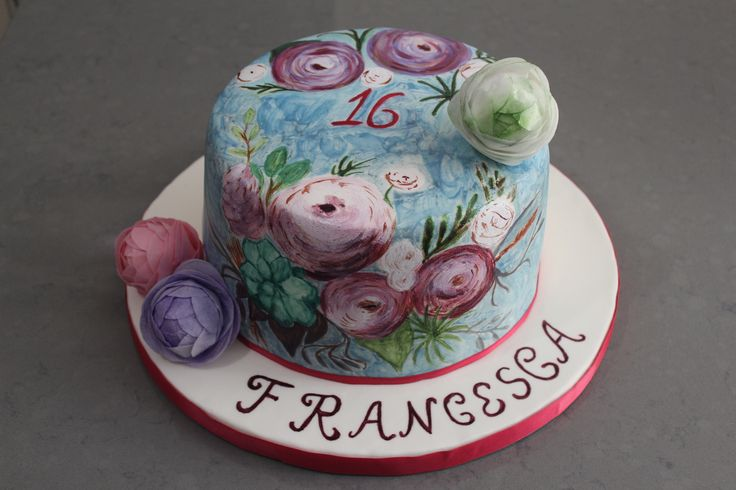 Hand painted cake with wafer paper ranunculus flowers.
