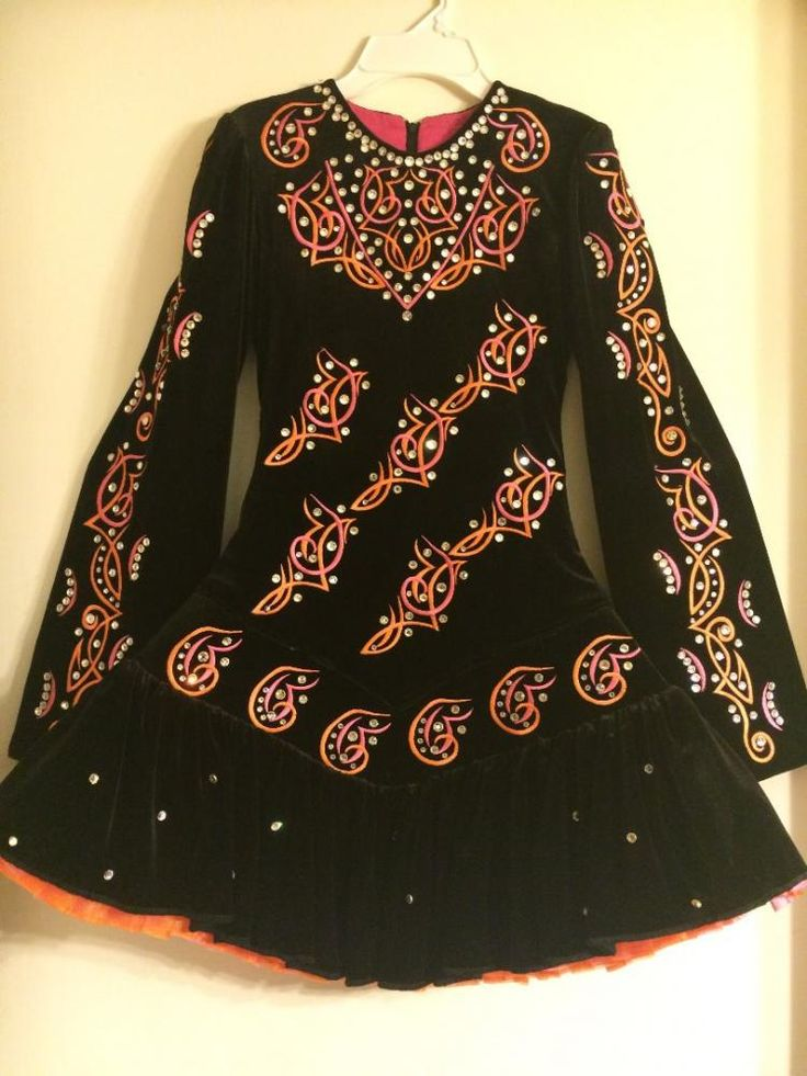 This elegant, hand made, black velvet dress is just stunning. Bright orange and pink add a pop of color through Celtic designs that light up the stage and