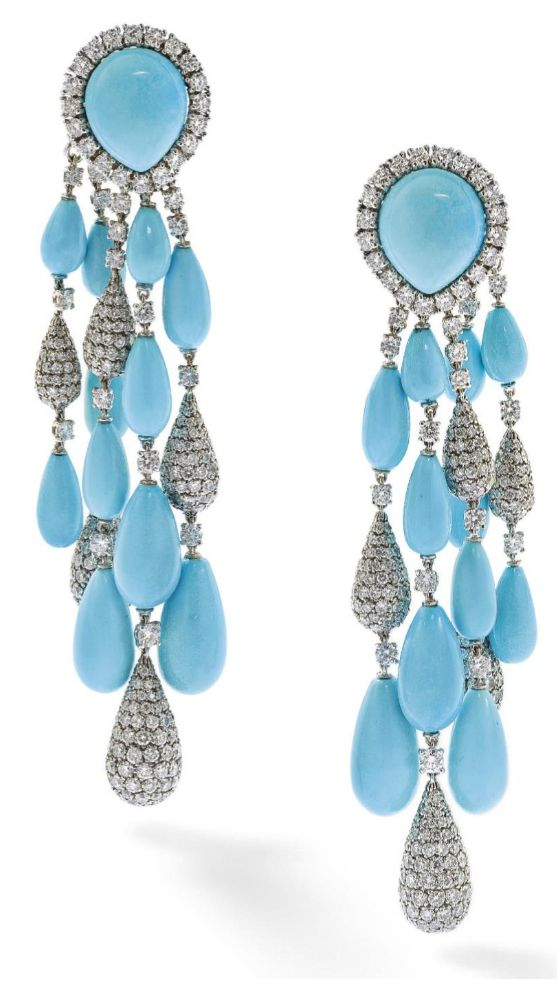 A pair of turquoise and diamond ear pendants, by Vita. Each designed as a cabochon turquoise and circular-cut diamond cluster clip suspending a graduating tassel of turquoise and pavé-set diamond drops to circularcut diamond spacers, length 8 cm, French import marks. Via Phillips.