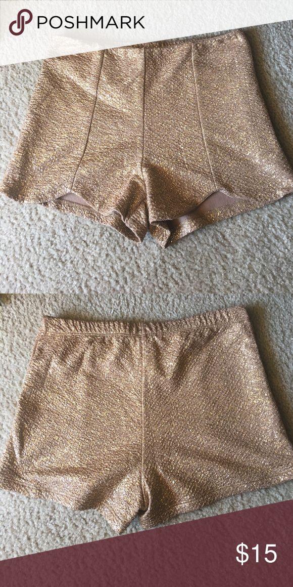 Gold sparkle shorts Worn once. Gold sparkle shorts. Super soft! Charlotte Russe Shorts Skorts