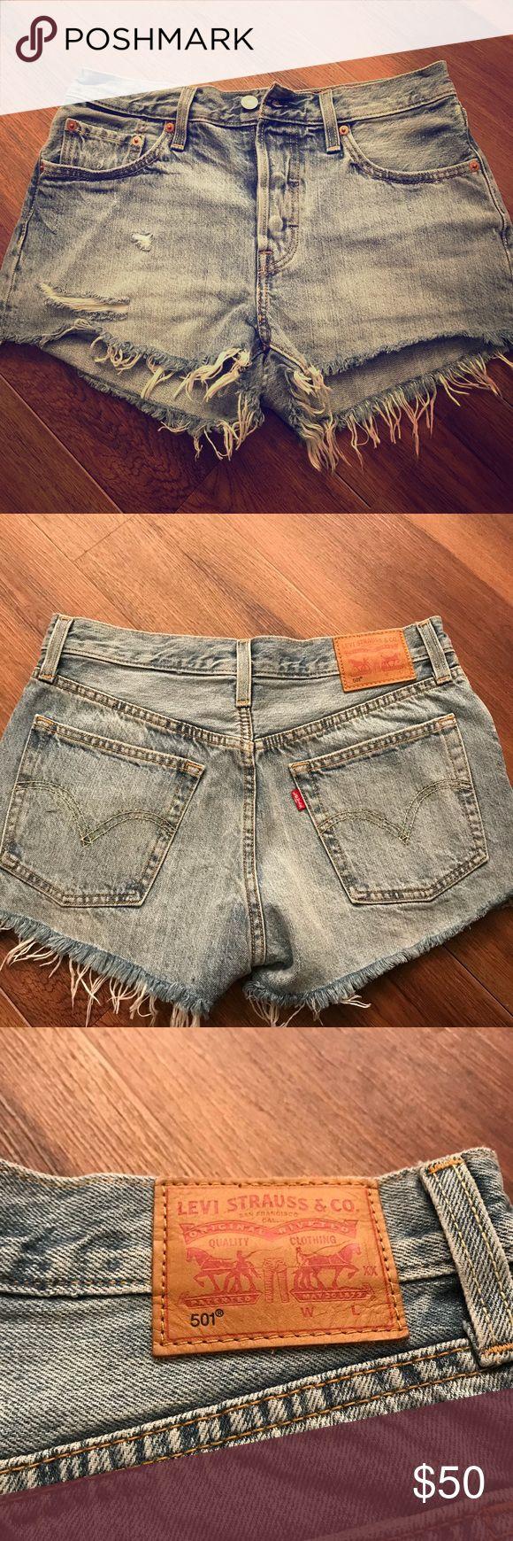 "Levi's 501 Denim Cutoff Shorts Levi's 501 cutoff denim jean shorts. Size 27. Waist measures 15"" lying flat. 11"" length. Super cute! Bought from boutique. Not homemade. Levi's Shorts Jean Shorts"