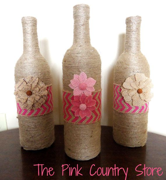 Decorative twine wrapped wine bottles, with pink chevron burlap and burlap flowers