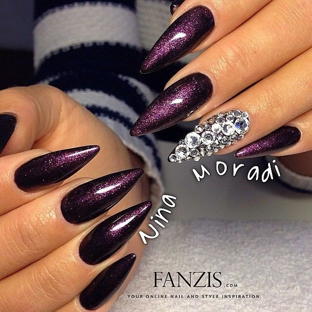 Cool purple...but could some on Splain to me what is with the pointed dagger nails?