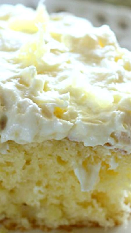 A light and fluffy pineapple-infused cake, topped with a sweet and creamy whipped cream frosting