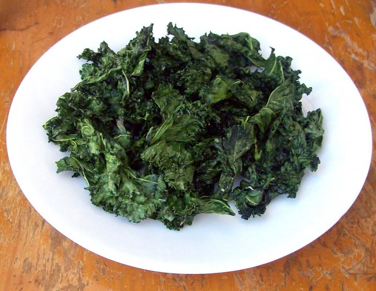 curly kale chips made in microwave; massage with coconut oil and sea salt; nuke for 3.5 minutes in the microwave.