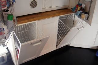 Laundry hamper - great idea if there's enough space in the laundry cupboard for a 'platform' under the machines