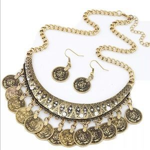 I just added this to my closet on Poshmark: Gold coin necklace & earrings statement piece. Price: $15 Size: OS
